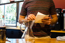 a man at a counter ordering coffee