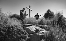 musicians playing outdoors standing around a cross
