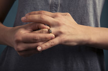 woman with her hand on her engagement ring