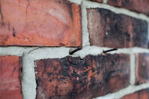 rusty nails in a brick wall