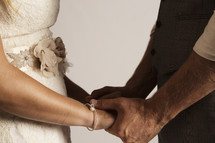 bride and groom holding hands in a portrait