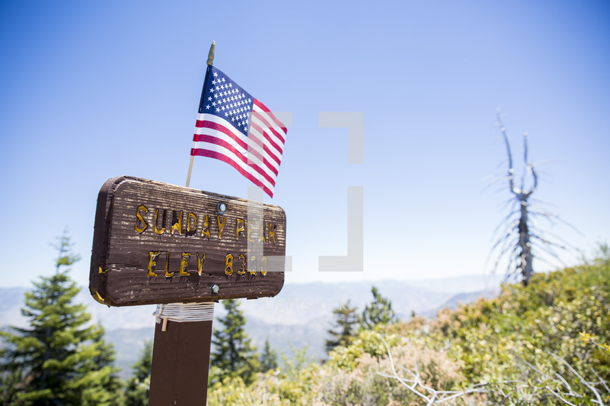 American flag on a sign for Sunday Peak