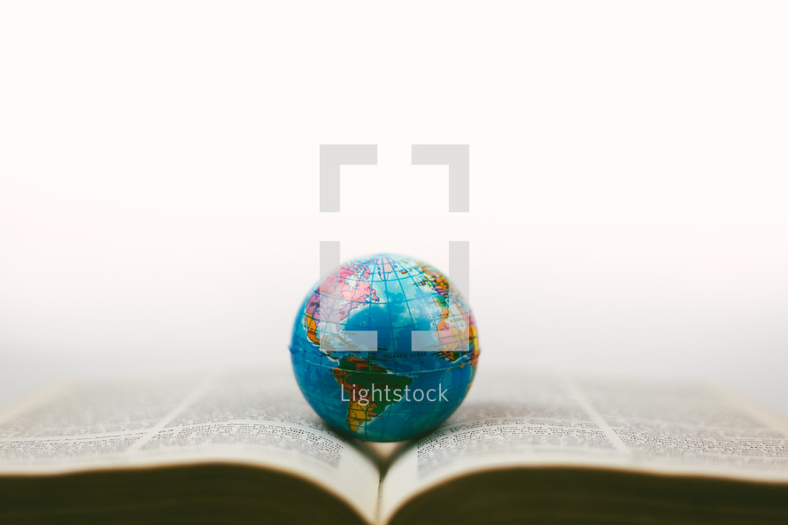 globe on the pages of a Bible