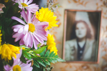 flower arrangement and old photograph of a woman