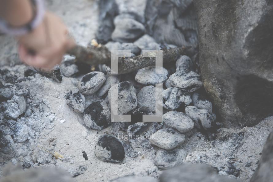 stirring coals