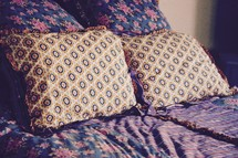 pillows on a made bed