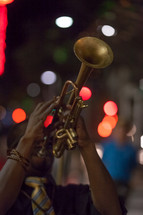 a man blowing a trumpet
