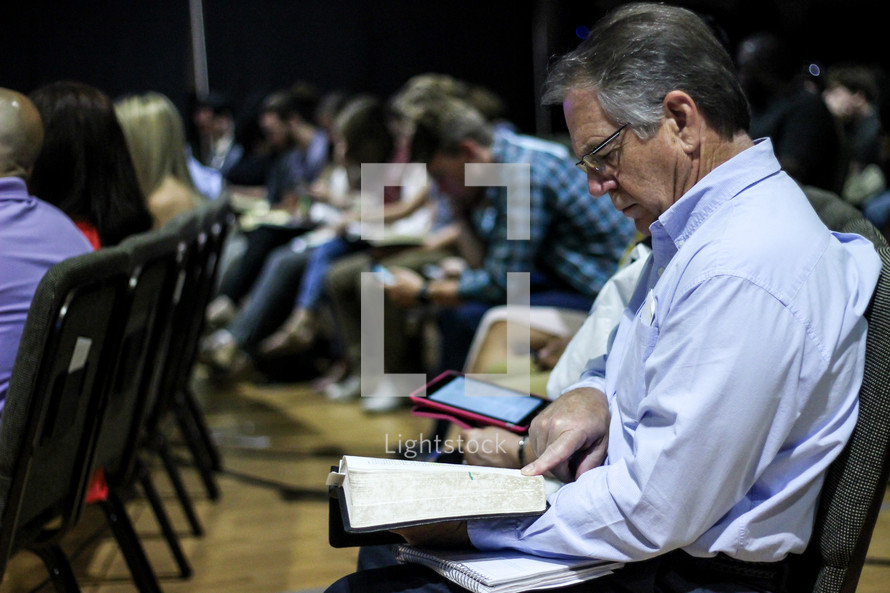a man reading scripture during a worship service