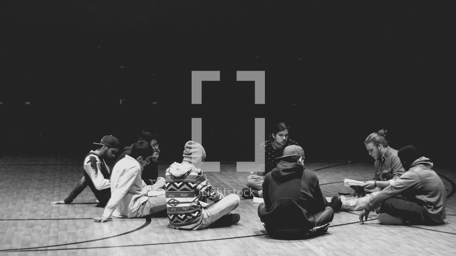 young men sitting on the floor in a Bible study discussion