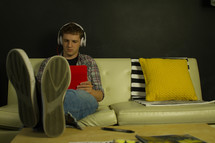teenager listening to headphones