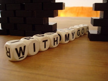 "Letter blocks spelling out ""with my God."""
