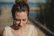 girl praying by a lake