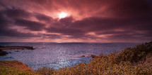 Ocean water under a purple haze sky.