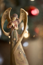 Christmas angel with bokeh backgound.