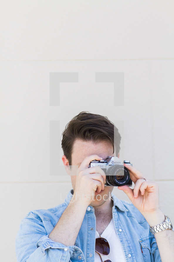 man taking a picture with a camera