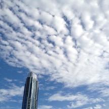 clouds above a sky scraper