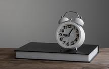 alarm clock on a journal
