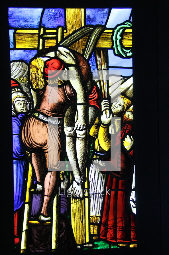 The descent of Christ from the cross stained glass window