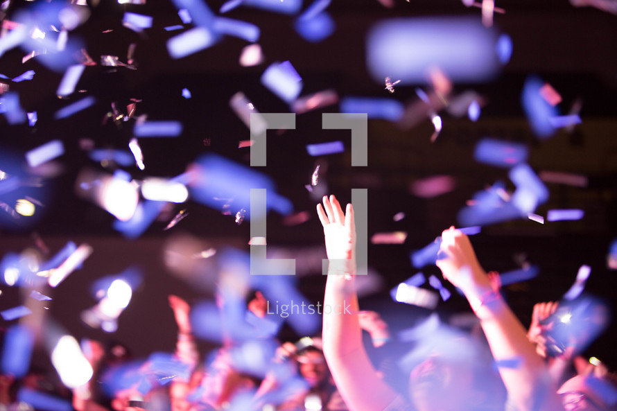 confetti falling on youth in a crowd at a youth rally