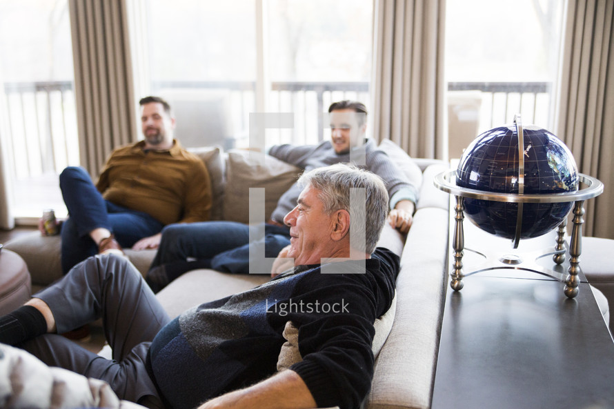 men sitting on a couch