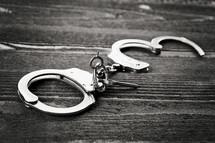 handcuffs on wood