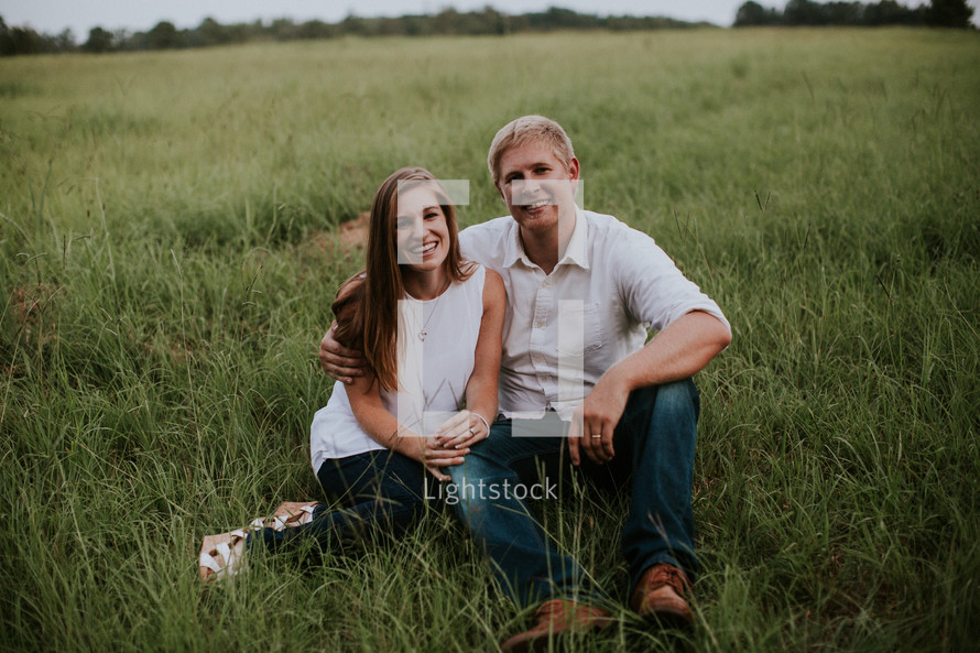 couple sitting in grass