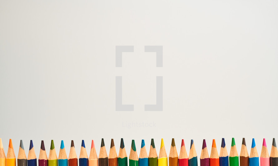 A line of colored pencils