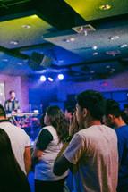 men and women attending a worship service