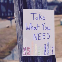 Take what you need flyer attached to a telephone pole