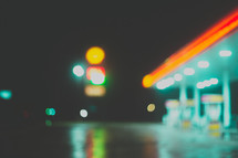 neon lights of a gas station at night