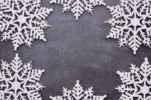 border of snowflakes on gray