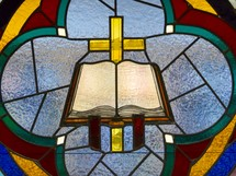 Stained glass window of a Bible