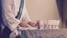 A Catholic deacon preparing the blessed sacraments for the Eucharist