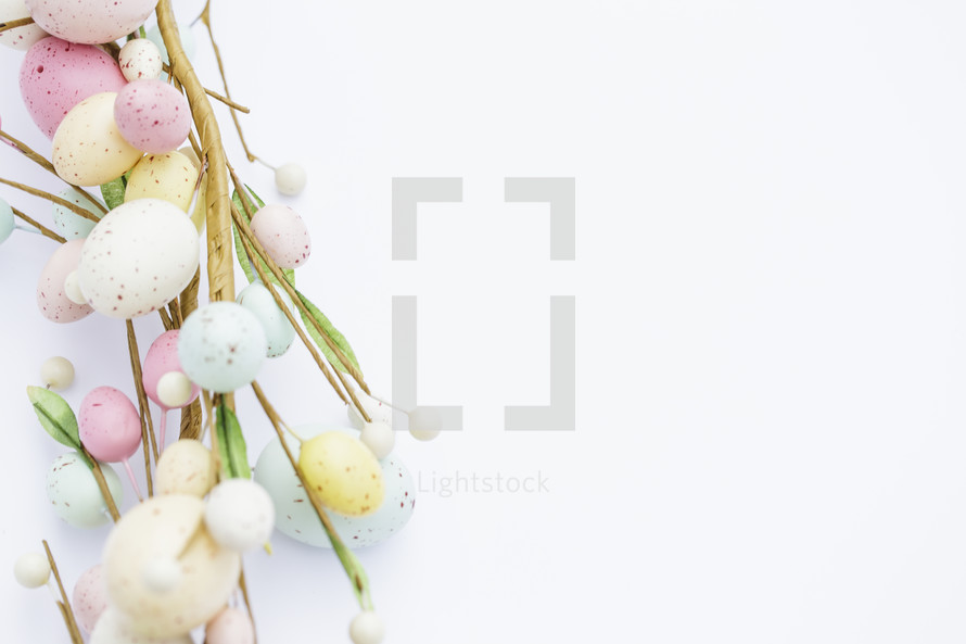 edge of an Easter wreath with Easter eggs