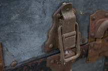 old latch on a rusty trunk