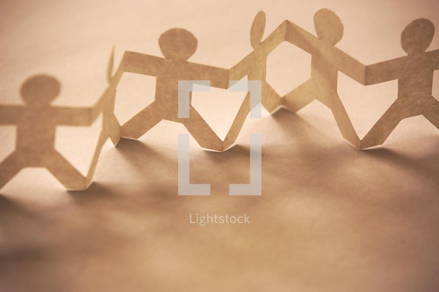paper dolls holding hands