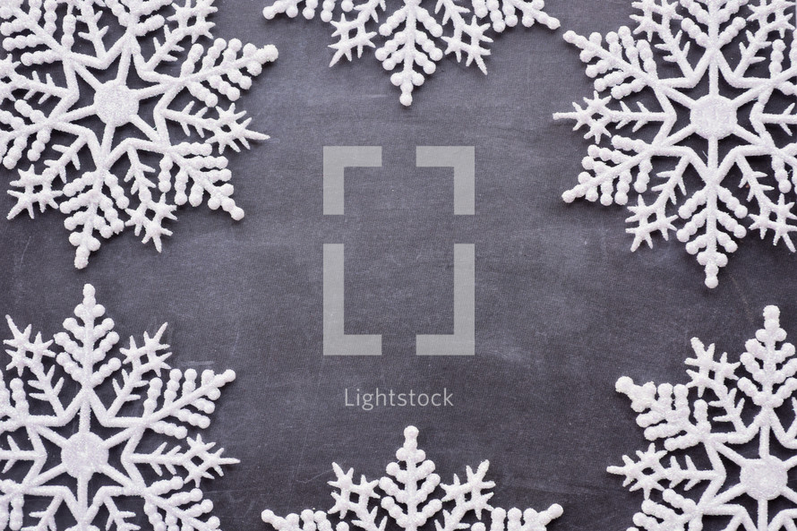 border of snowflakes on gray