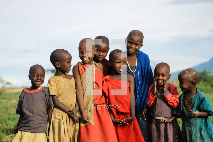 a group of smiling village girls in Africa