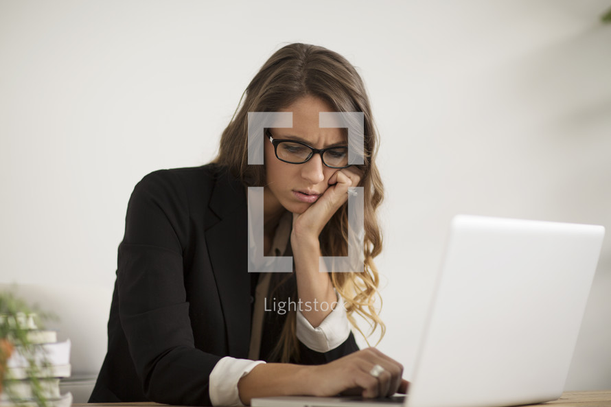an unhappy woman at work.