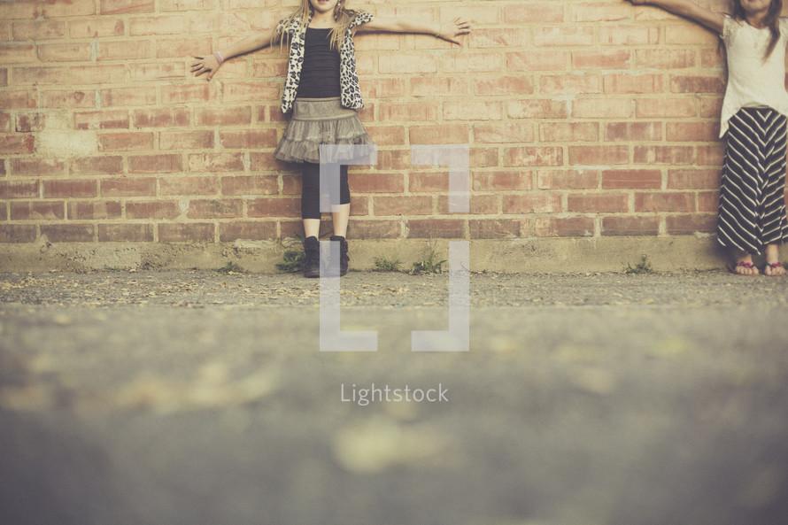 girls against a brick wall