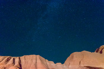 stars over red rock mountains