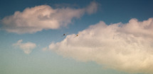 planes flying through clouds
