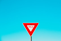 yield sign and blue sky