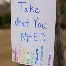Take What You Need flyer attached to a telephone phone