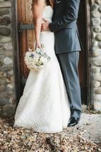 torso of a bride and groom