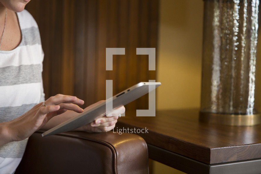 a woman using an iPad