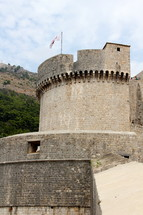 Castle walls with fortified tower