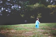 toddler girl walking in grass