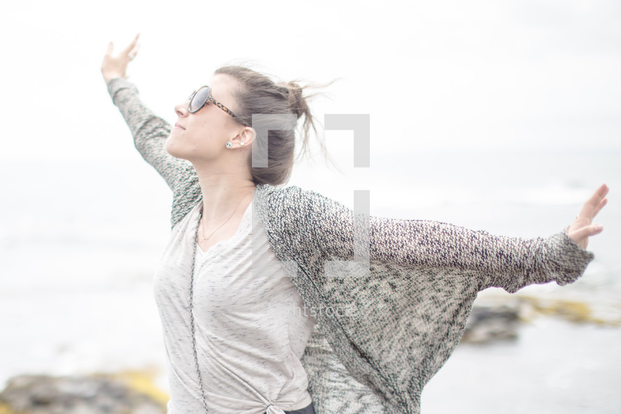 woman with spread arms enjoying the outdoors