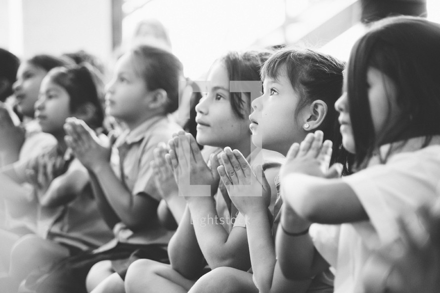girl children praying together